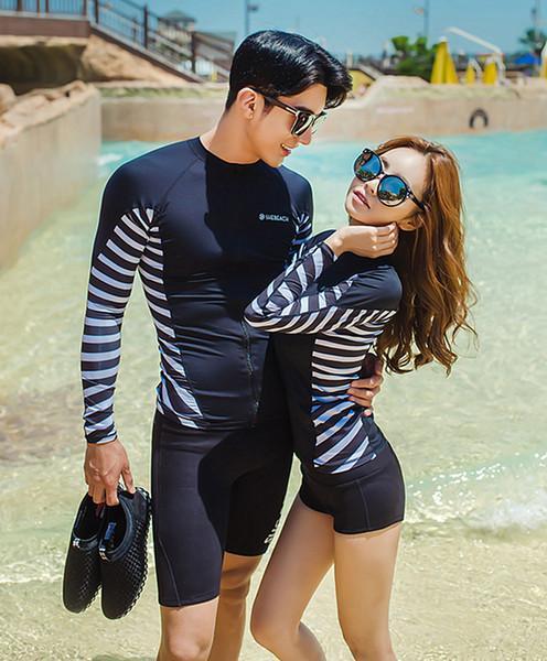SM-V1-480 ชุดว่ายน้ำแขนยาว สีดำ ด้านข้างแต่งลายเส้นสลับสีขาวดำ กางเกงขาสั้นสีดำ