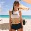 388 ชุดว่ายน้ำ เสื้อกล้ามเอวลอยสีขาวสกรีนอักษร กางเกงสีดำ thumbnail 1